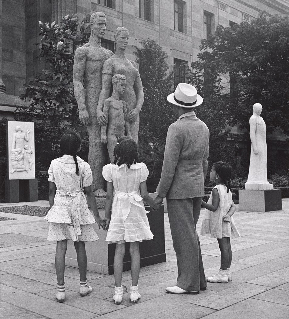 Black Man with Three Little Daughters Looking at Sculpture